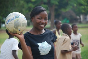Children First.  Caption: An orphan herself, Fortune helps other children learn about HIV through the Grassroot Soccer program. Photographer: Heather Quinn