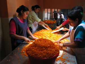 Women preparing vegetables at San Judas, Guatemala.