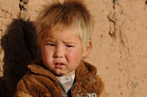 A Hazara Afghan boy sits in the sunshine in Bamiyan. Bamiyan, some 124 miles northwest of Kabul, stands in a deep green and lush valley stretching 100 kilometers through central Afghanistan, on the former Silk Road which once linked China with Central Asia and beyond. The town was home to nearly 2,000-year-old Buddha statues before they were destroyed by the Taliban, months before their regime was toppled in a US-led invasion in late 2001. Credit: AFP Photo/Shah Marai