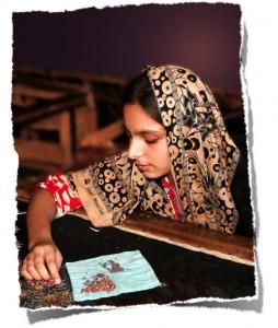 One of Bibi's daughters at work embellishing a shalwar. Photo Credit: USAID/Pakistan