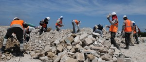 Workers sort rubble in Port-au-Prince, Haiti, on August 6, 2010. Photo source: Kendra Helmer/USAID