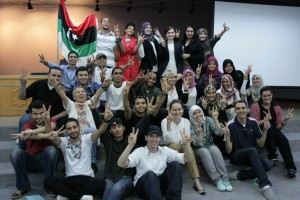 "Youth participants and workshop trainers from the Helsinki Foundation show ""V"" signs for Victory. Photo Credit: USAID"