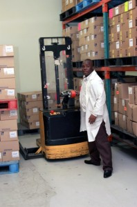 A hand-operated fork lift helps navigate tight warehouse spaces.Photo Credit: Desiree Swart