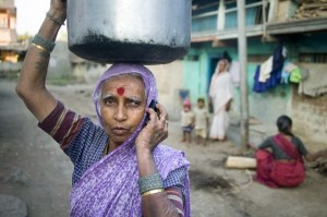 A woman on a phone in India. Photo Credit: USAID