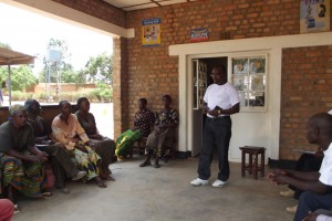 Isaac  facilitates a group session on FP with health workers at Kawama Village Health Center. Photo Credit: MSH