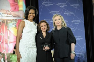 U.S. Secretary of State Hillary Rodham Clinton, right; and First Lady Michelle Obama, left; pose for a photo with 2012 International Women of Courage (IWOC) Award Winner Jineth Bedoya Lima of Colombia, at the U.S. Department of State in Washington, D.C., on March 8, 2012. Photo Credit: State Department