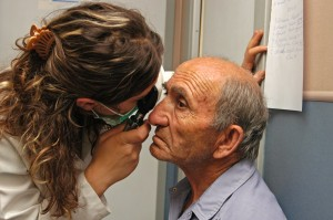 The Armenian EyeCare Project (AECP) is the brainchild of an Armenian-American diaspora-led organization, which launched its efforts in 2003 to strengthen the eye-care system and reduce preventable blindness in Armenia. In 2004, USAID and AECP joined forces. Through the partnership, USAID/Armenia helped AECP scale up its programs, which complemented the mission's health care goals for the country. For part of that effort, AECP brought in a mobile eye hospital, which made stops in 90 percent of Armenia's communities to provide eye exams and necessary treatments. Pictured: a man receives an eye exam.  Photo credit: AECP