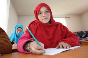 18-year old Marian has been attending classes to learn to read and write for four months now. WFP food rations mean she can learn and contribute to her family's upkeep. Photo Credit: Silke Buhr/World Food Programme
