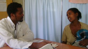 Nurse Haileshet Bekele at Tulla Health Center counsels Birtukan Bezabih, a mother of three. Photo Credit: USAID