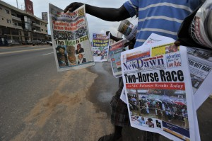 Vendors sell newspapers during the 2011 presidential elections in Liberia. USAID supported a media initiative to strengthen local media coverage of the elections and encourage independent reporting of election results through new media.  Photo credit: Issouf Sanogo/AFP