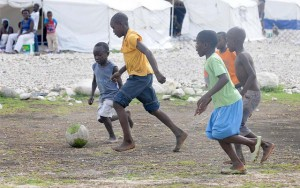 Several boys play on a soccer field at Tabarre Issa Emergency Relocation Camp on June 7, 2010. Photo Credit: Kendra Helmer/USAID
