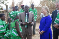 Secretary Clinton With the Lumbadzi Milk Bulking Group in Malawi  Dairy farmer Margaret Chinkwende explains her work to U.S. Secretary of State Hillary Rodham Clinton and Martin Banda of the U.S. Agency for International Development (USAID) in Lilongwe, Malawi, August 5, 2012. Photo Credit: State Department photo/ Public Domain]