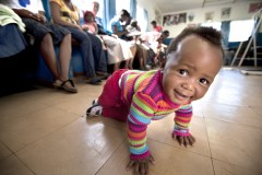 Happy baby crawls around health clinic in Swaziland. Credit: James Pursey, Elizabeth Glaser Pediatric AIDS FoundationThis year, the International AIDS Society (IAS) is hosting the 19th International AIDS Conference, which takes place in Washington, DC, from July 22–27. To learn more about USAID activities, visit usaid.gov