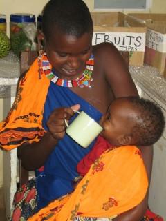 Mother feeding a child in Kenya