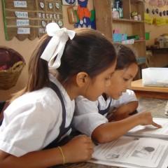 Girls reading in Peru. Photo Credit: USAID