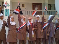Yemeni school girls wave the Yemen flag last autumn after USAID efforts helped return children to classes following the 2011 Yemen uprising. Photo Credit: USAID