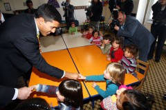USAID Raj Shah greets young Syrian children in Turkey. Photo Credit: USAID