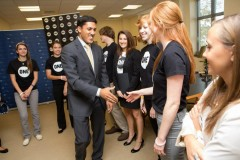 Administrator Shah greets students from University of Michigan's ONE Campaign campus group this past October. Photo Credit: Gerald Ford School of Public Policy.