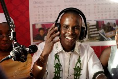 A  youth participating in a radio program sponsored by USAID. Photo Credit: USAID