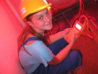 A young woman from Zvornik in north-east Bosnia-Herzegovina is using a blower door and meter to measure air leakages to determine weatherization strategies in a rural house for the upcoming winter.