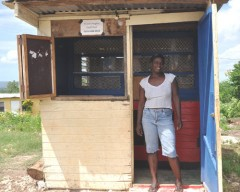 After closing her shop and fleeing her community of Gravel Heights, Paulette Simpson was happy to return home and reopen her grocery shop, confident in the ability of the Jamaica Constabulary Force to keep her safe from gangs. Photo Credit: USAID