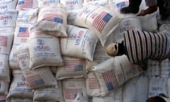 Palestinians unload bags of flour donated by USAid at a depot in the West Bank village of Anin near Jenin. Photo Credit: Mohammed Ballas/AP.