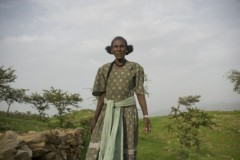 Medhin Reda in her teff field at her home in Tigray, Ethiopia. Oxfam America and partners are working on the Rural Resilience Initiative, which offers the poorest farmers a chance to buy weather insurance. For those too poor to have cash, they can pay for their premiums by working on community projects. The initiative also promotes a variety of tools that will help rural families build their resilience, including access to credit, encouragement to save, and steps to reduce the risk of disaster. Photo Credit: Oxfam America