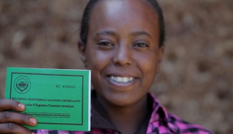 Asilya Gemmal, 14, of Gure Tebeno Union, proudly displays her land certificate obtained from the Ethiopian Government with USAID assistance. Photo credit: Links Media
