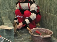 Shalva Grigalashvili, one of USAID/NEO beneficiaries, tiling a guesthouse bathroom in Kvishkheti village of Khashuri municipality. Photo credit: USAID/NEO