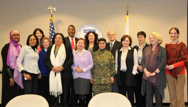 USAID staff host International Women of Courage Awardees. Back row, from left: Fartuun Adan, Somalia; Summer Lopez, USAID; Franklin Moore, USAID; Beth Hogan, USAID; Ambassador Donald Steinberg, USAID; Kathleen Campbell, USAID; Amber Ussery, USAID; Front row, from left: Dr. Josephine Odumakin, Nigeria; Roberta Mahoney, USAID; Julieta Castellanos, Honduras; Sarah Mendelson, USAID; Malalai Bahaduri, Afghanistan; Yelena Milashena, Russia, Key Freeman, USAID. Photo credit: Pat Adams, USAID