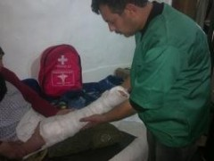 A doctor tends to Hajji Rajaa's leg in a clinic in Rif Damascus, Syria. Photo credit: USAID Partner