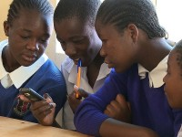Students play a mobile game in Kenya. Photo credit: Ed Owles, Worldview