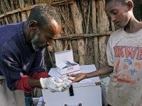 A community health worker in rural Ethiopia tests a boy for malaria. Photo credit: Bonnie Gillespie, Photoshare