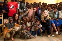 WWE Divas  Alicia Fox and Natalya Fox during their visit to Rwanda. They helped distribute bed nets to mothers and families, and visited health clinics and youth centers at the camps. Photo credit: Craig Ambrosio, WWE