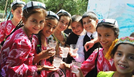 School children in Khatlon enjoy their first taste of drinking water outside their school. Photo credit: USAID