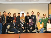 Iraqi and Palestinian teams in front of the USAID seal from this morning's roundtable. Photo credit: USAID