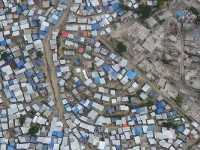 Taken during a United Nations flight, the photo shows one of the many campsites that have sprouted throughout Port-au-Prince, Haiti, since more than 1 million people were left homeless after the Jan. 12, 2010, earthquake. Photo credit: Andrea Sternberg, USAID