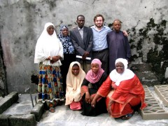 Christopher Hook with members of Maman An'Sar. Photo credit: USAID