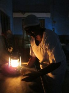 Midwife in Samaru Clinic using typical kerosene lighting. Photo credit: We Care Solar
