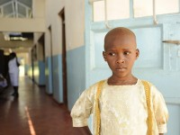An HIV-positive child at the Muranga District Hospital in Kenya waiting for treatment. Photo credit: Casey Kelbaugh, International Center for AIDS Care and Treatment Programs, Columbia University School of Public Health