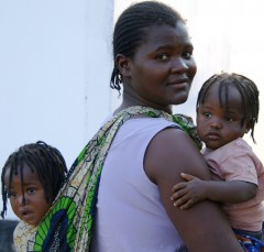A woman and her children after a family planning consultation at Kalingalinga Clinic in Lusaka, Zambia, 2009. Photo Credit: Arturo Sanabria