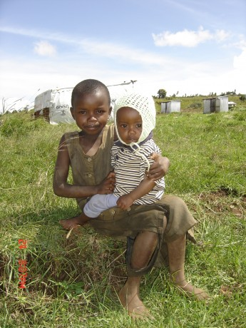 Two displaced Kenyan children receive USAID assistance