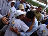 Raj hugging woman in Colombia