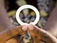 A woman holding a ring. Photo Credit: USAID