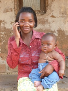Mother with a mobile phone. Photo credit: VillageReach