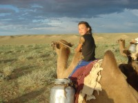 Girl travels by camel in Mongolia Photo Credit: James Orlando