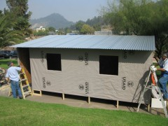 USAID built temporary shelters in Chile, using a combination of durable plastic sheeting and wood boards, to meet humanitarian needs in 2010. Photo credit: USAID