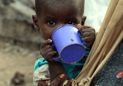 A displaced child feeds at a camp in Mogadishu—one of the more than 13 million people affected by the 2011 famine in Somalia. Photo credit: AFP PHOTO/ Mustafa Abdi
