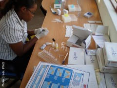 Doctor prepares malaria treatment. Photo credit: IMAD
