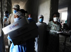 Personnel distribute USAID hygiene kits at a Cholera Treatment Center in Verrettes in the Artibonite department of Haiti. Photo by Kendra Helmer/USAID